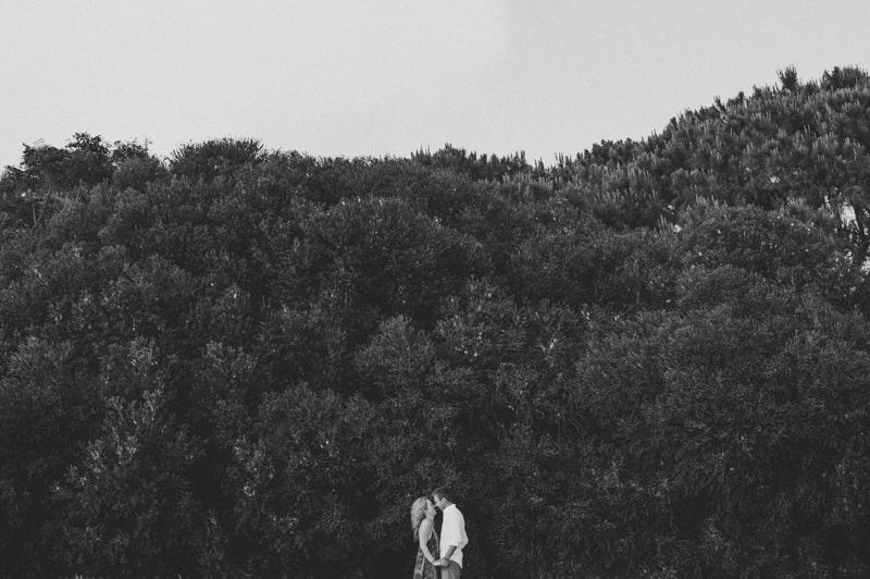 Tiny couple and a huge tree