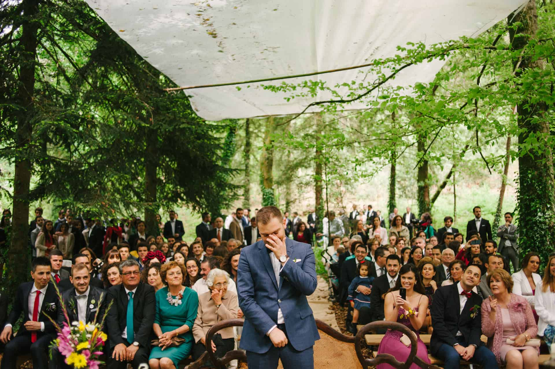 outdoor wedding groom crying at the altar