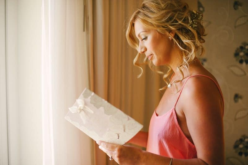 portrait of bride reading a note from groom