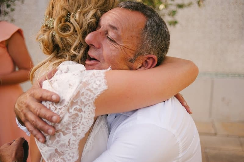 father-in-law and bride hugging