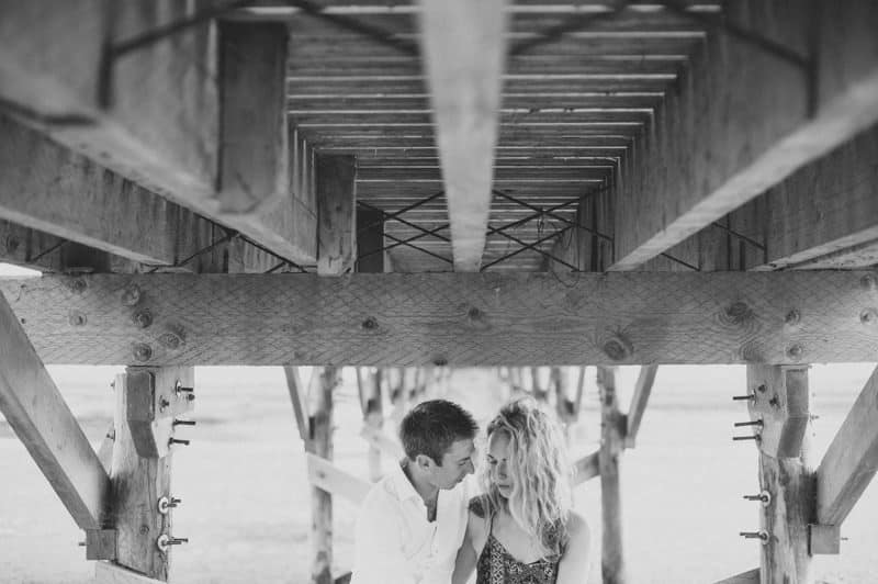 Romantic portrait under a bridge