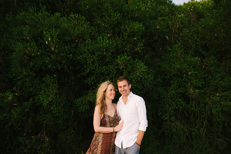 Portrait of couple with tree background
