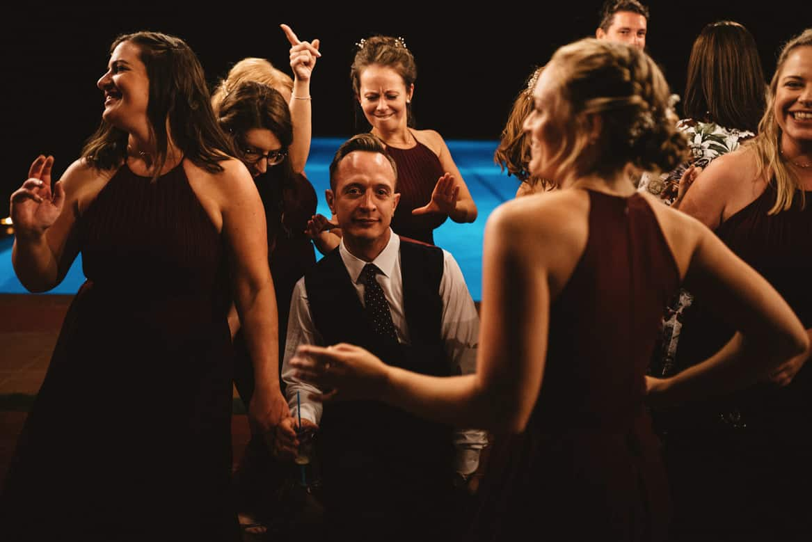 groom surrounded by bridesmaids during villa di ulignano wedding