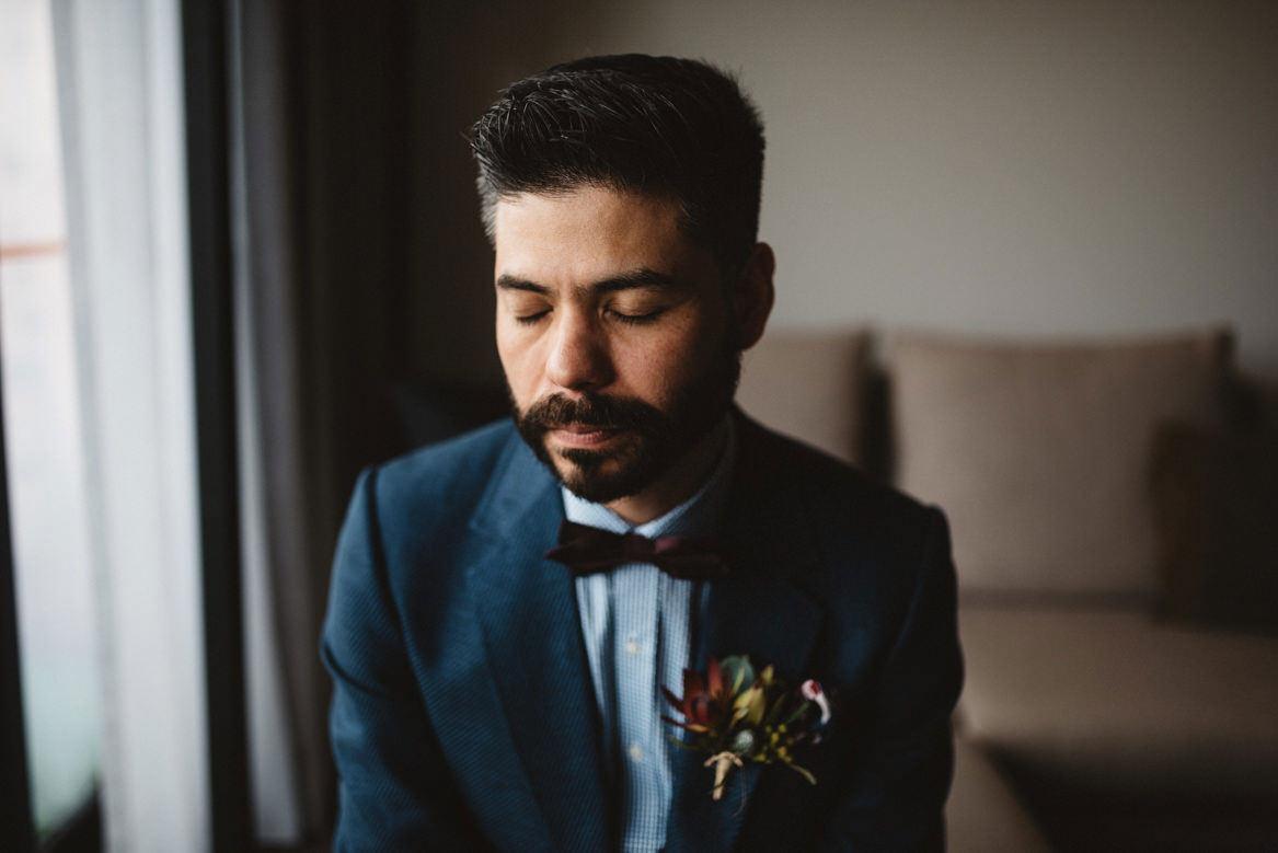 tasmania wedding photographer portrait of groom blue jacket