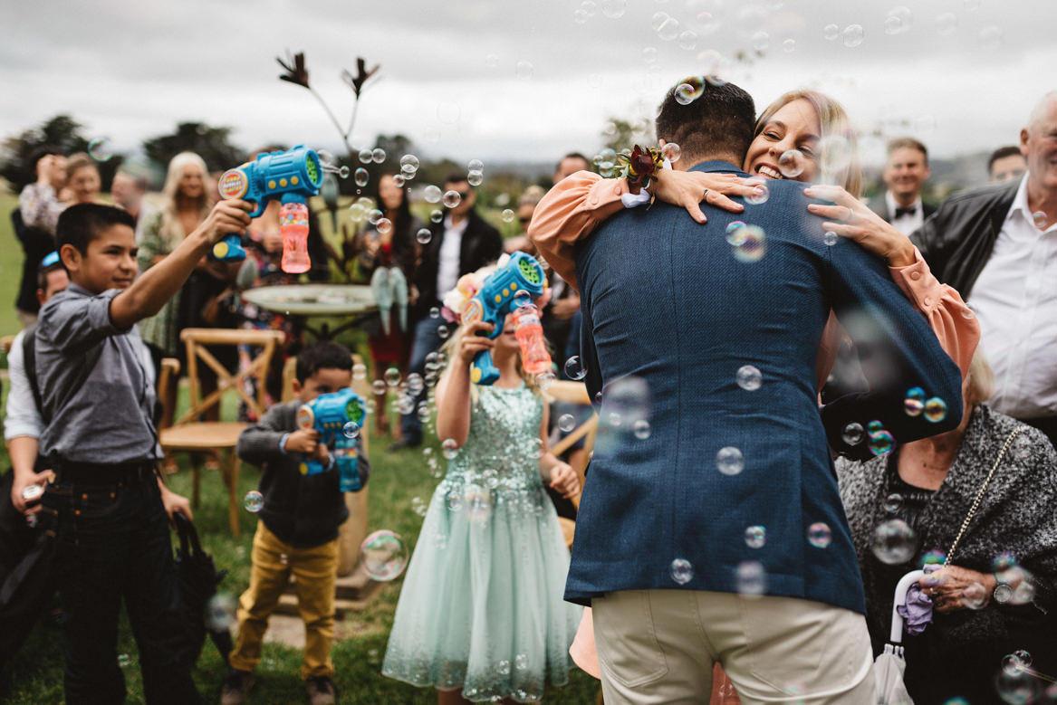 tasmania wedding photographer pooley wines wedding bubbles and hugging