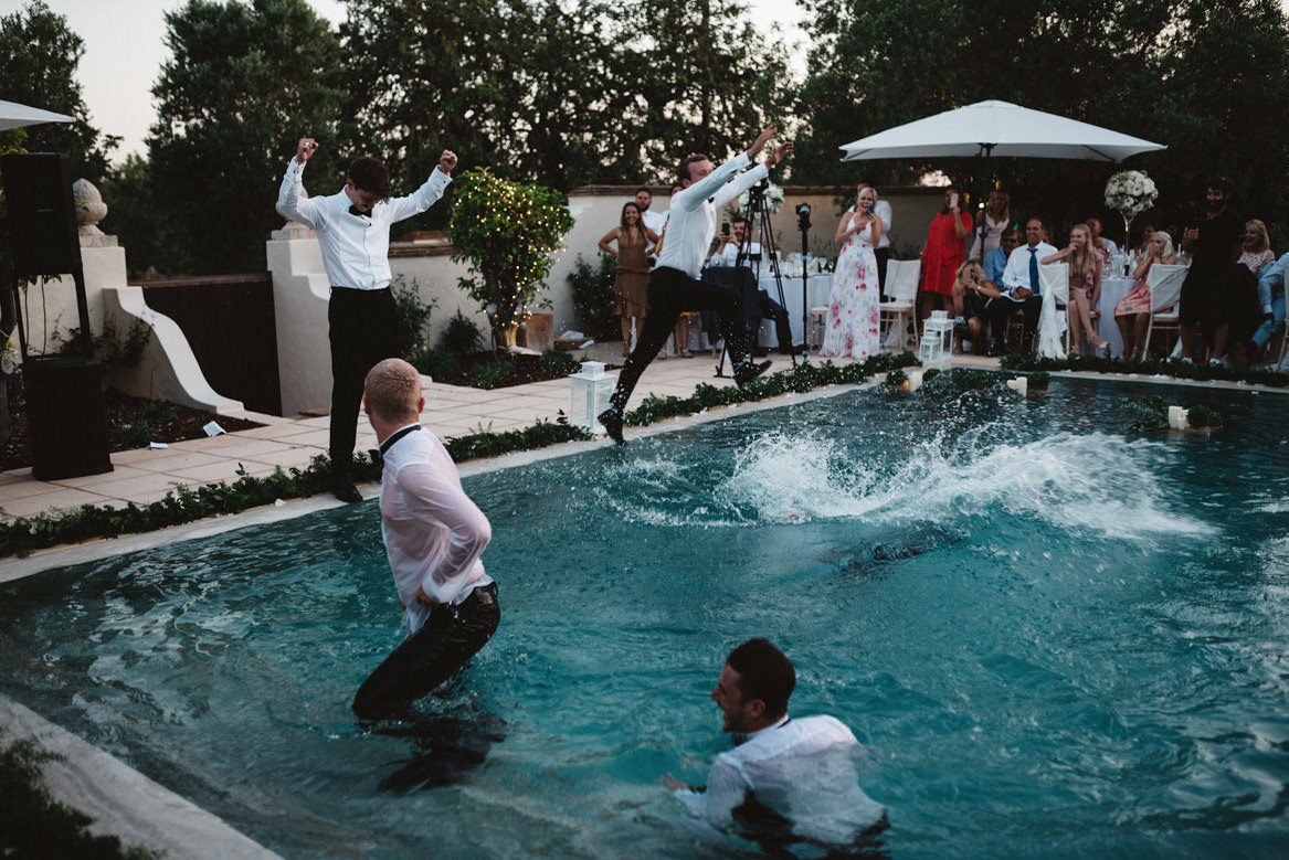groomsmen bring thrown in pool during casa rupi wedding