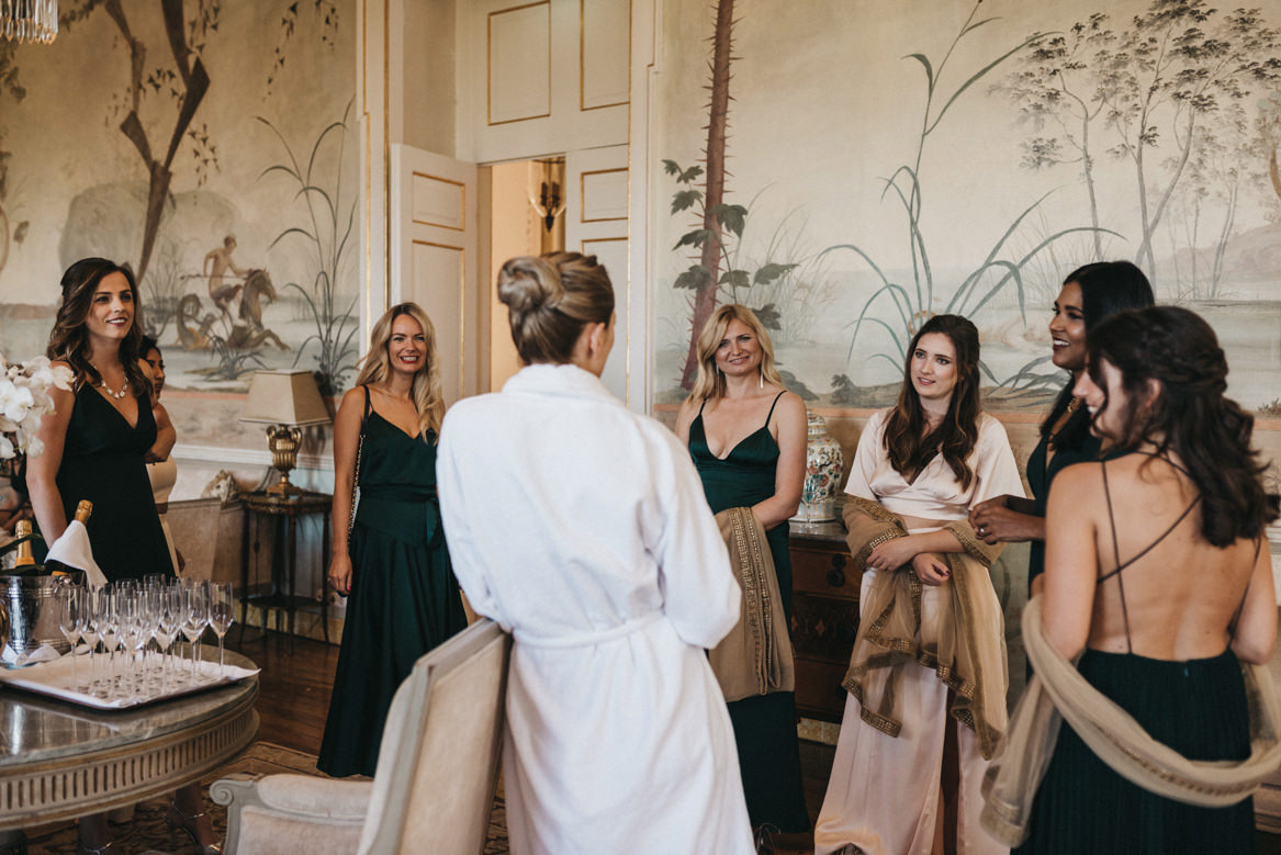 Bride talking to bridesmaids