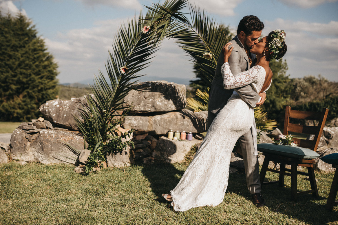 Passionate kiss in outdoor ceremony