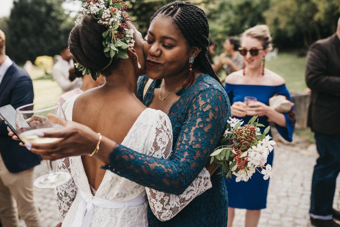 Bride hugging friends after ceremony