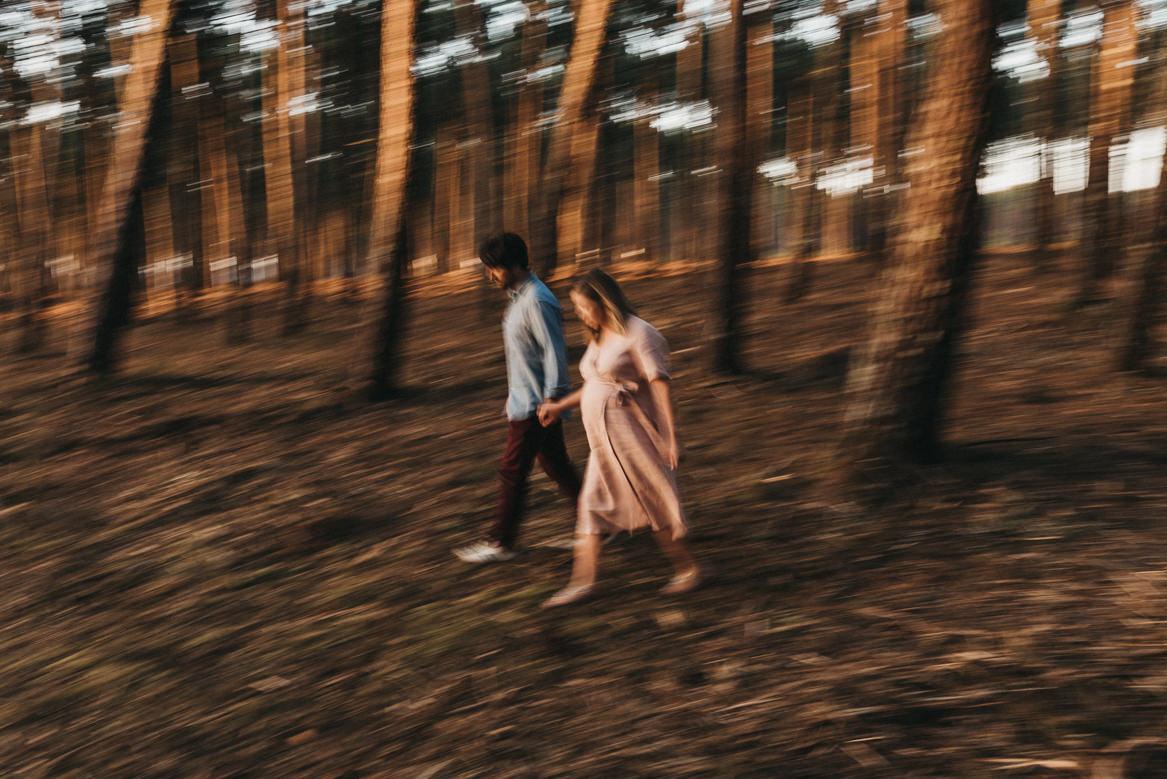 slow shutter portrait of couple in pine tree forest